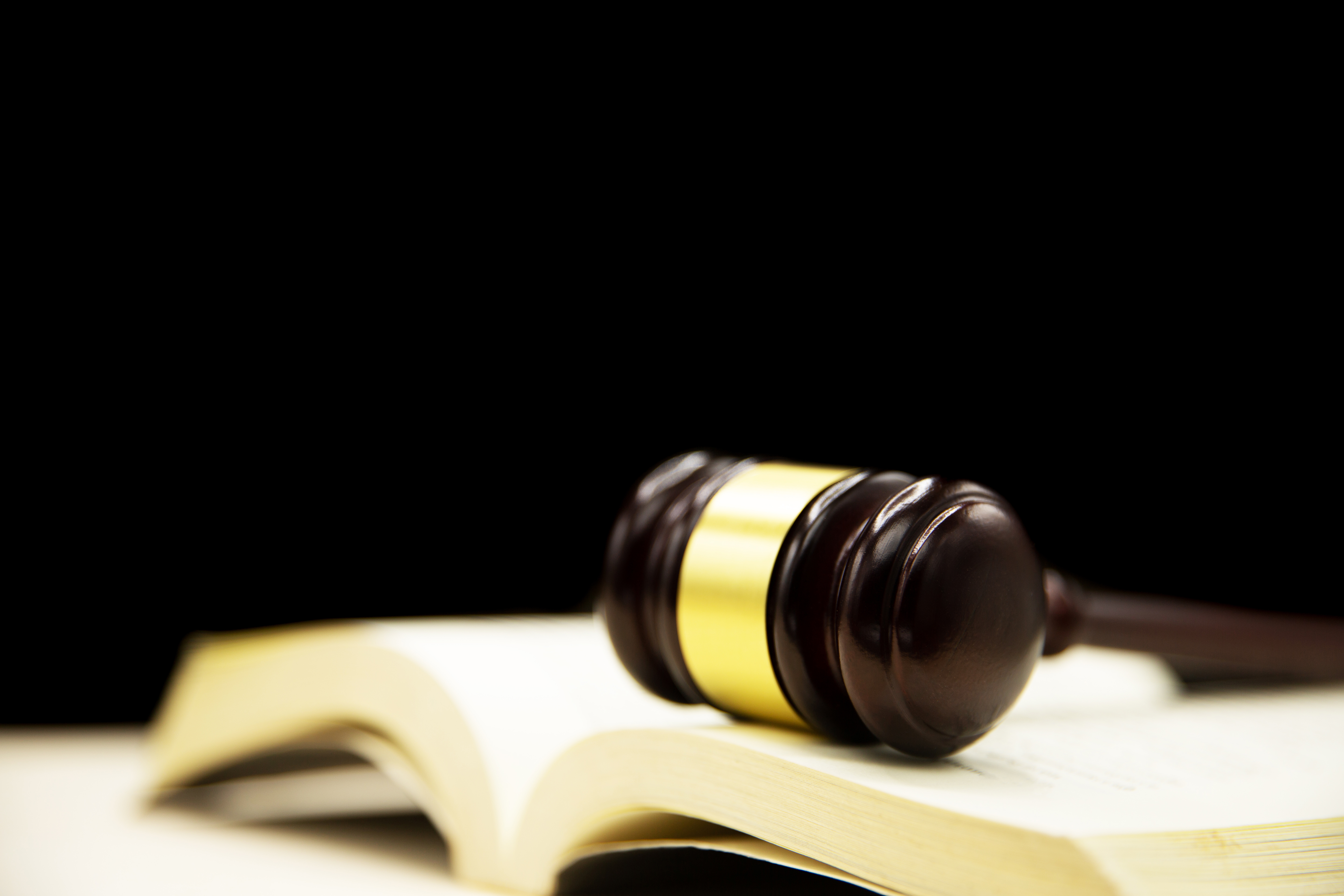 judge-gavel-on-book-and-wooden-table