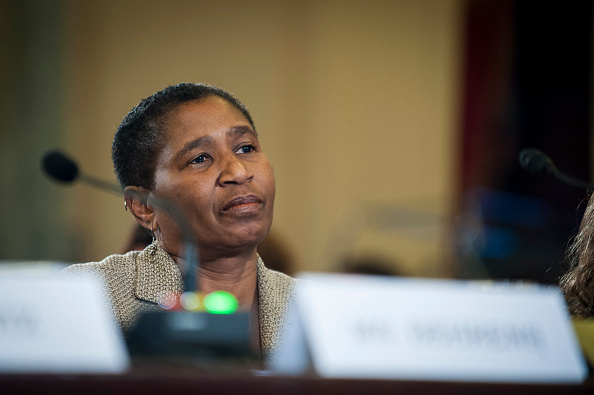 Michele-Roberts-Sitting-at-a-Table