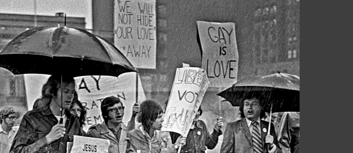 We-Demand-Demonstration-Protestors-with-Gay-is-love-signs-in-the-rain